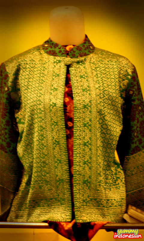 a woman's shirt made of songket